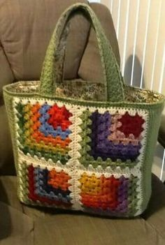my mitered granny tote, using the mitered granny square pattern. my mitered granny tote, using the mitered granny square pattern. Crotchet Bags, Crochet Tote, Crochet Handbags, Knitted Bags, Crochet Purses, Crochet Squares, Crochet Granny, Sac Granny Square, Granny Squares