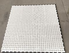 White Thassos Marble + Mother Of Pearl Basketweave Pattern Mosaic Tile. Available at tilebuys.com