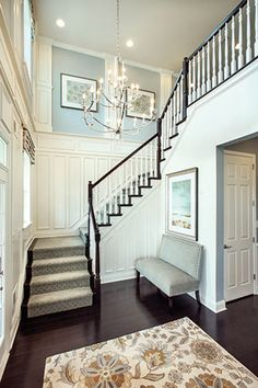 Love the stairs Foyer Paint Color. The paint on the upper wall insets is Sherwin Williams Samovar Silver. The paint on the lower walls is Accessible Beige and the trim is Cottonwhite. Mary Cook Associates Inc. Luxury Interior Design, Home Interior, Interior Paint, Interior Ideas, Interior Colors, Contemporary Interior, Design Entrée, House Design, Design Ideas