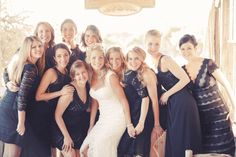 Mismatched navy blue laced bridesmaid dresses