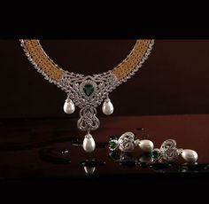 It is a designer range of fine hand craftes jewellery exclusively made with a combination of natural colored Champagne Diamonds. Diamond Choker, Diamond Jewelry, Gold Jewelry, Diamond Pendant, Pendant Jewelry, Jewelery, Gold Ruby Necklace, Heart Jewelry, Necklace Designs