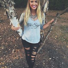 How cute is our CM Alyson in this script Tri Sigma v-neck? We love the addition of a statement necklace and distressed jeans. How do you style your letters?