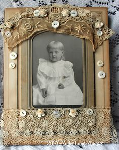 Gorgeous lace edging with button embellishments frame this sweet vintage portrait just perfectly.