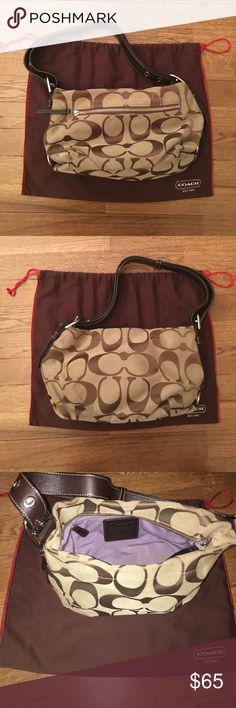 Coach classic brown handbag Light with dark brown coach symbols, has light purple interior and zipper pockets inside. Coach Bags Mini Bags