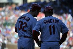 Rob Johnson talks with third base coach Jose Oquendo  after hitting a triple against the Chicago Cubs during the seventh inning...nice debut for Johnson.... Cards won 3-2.  7-12-13