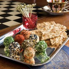 Goat Cheese Truffles    Goat cheese balls rolled in seeds, herbs, and spices give these appetizers bold color and taste.