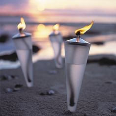 Cone Torch - Danish Design Outdoor - Danish Lifestyle - Welcoming Guests with a Row of Flaming Torches (Coke Bottle Candles) Driftwood Beach, Light Of The World, Oil Lamps, Outdoor Lighting, Beach Lighting, Candle Lighting, Danish Design, Logs, The Great Outdoors