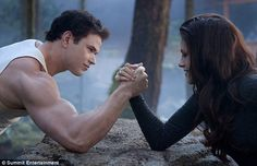 Bella and Emmett testing her new vampire strength.