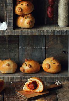 "Kanela y Limón: Cerditos ""preñaos"" Pregnant pigs. Pig shaped rolls stuffed with chorizo. Mmm mmm."
