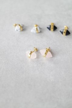 """Skip the plain stud and amp up your earring game with these striped pointed stones. Details: - .7"""" wide - .4"""" deep - Post backs - Gold plated metal"""