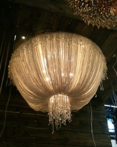 Chandelier (DIY with a hula hoop, an embroidery hoop, tulle, some beads & mini lights?) head table?