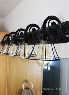 16 Brilliant Lighting Ideas You Can DIY on a Dime & Bring an element of industrial cool into your bathroom with a ... azcodes.com