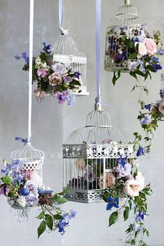 Wedding flower display with bird cages... Don't know where we would hang these, lol, but just add some succulents and it would be gorg