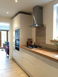 Image result for tiles above stove white gloss kitchen