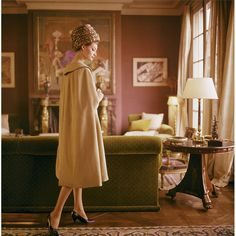 France 1960's Captured here by famed Kennedy's photographer is a model in the Paris living room of legendary interior designer Henri Samuel.