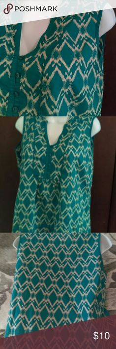 "St. John's Bay Sleeveless Blouse Turquoise and Cream chevron like print.  Open collar 3/4 button down 23"" long  20"" bust St. John's Bay Tops Blouses"