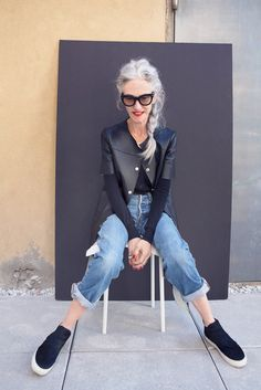Linda Rodin/ Black leather coat and slip on sneakers.....cool
