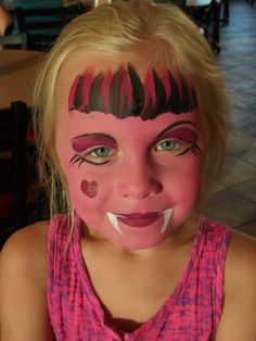 This is Monster High inspired, but something like this for face paint- Cute monsters