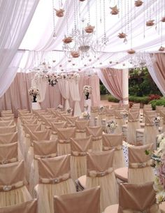 Our Bridal Champagne chair covers look so pretty at this venue! | #hanginglights…