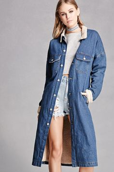 A midweight denim jacket featuring a Sherpa fleece lining, a basic collar, button front, button flap chest pockets, long dropped sleeves, slanted front pockets, and a longline silhouette. This is an independent brand and not a Forever 21 branded item.