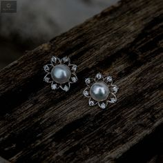 Beautiful studs with pearls and zirconia stones that are beautiful and attractive to women and girls #silver #silverjewellery #pearls #pearljewellery #zirconiastones #studs #silverstuds #beautifulearrings #silverstore #pearlearrings #silverornaments #pearlstuds #earringswithpearls #stonedearrings #earringswithstone