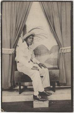 Souvenir Photograph of a Black Man Smoking a Cigar with a Naive Background | Flickr - Photo Sharing!