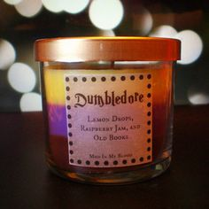 Dumbledore Scented 4oz Candle- Lemon Drops, Raspberry Jam, Old Books -- I actually want this, those scents are great!