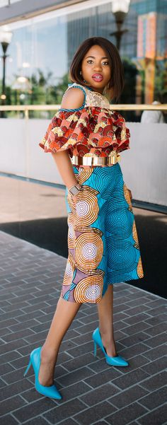 Such a stunningly irresistible African print romper! I wouldn't be surprised if she stopped traffic wearing this elegant mixed print ankara African style. The cold shoulder, lace detail and matching blue heels definitely makes this outfit a hit! Adding to my wishlist as a gift idea today. Fall style, dutch wax, kente, kitenge, dashiki, African styles, African prints, Nigerian style, senegal fashion#ankara#africanprint#kente#ootd#romper