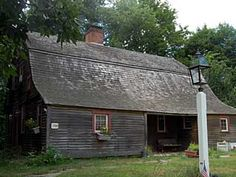 Vernon, Connecticut.  Historic 200 year old Dutch Colonial with 2 working fireplaces, new wood shingled roof, modern open kitchen with Jenn Aire convection stove and cook oven, dishwasher and garbage disposal, newer oil furnace and hot water tank, downstairs has original wide wood floor boards, second floor carpeted, timber construction, walking distance to park.  $ 229,900.00