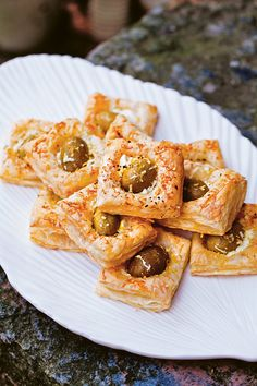 Store-bought puff pastry + olives + feta + lemon zest. That's it. Serve these puffs warm or cold; either way, they're great with a glass of wine.