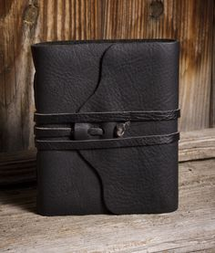 Pocket Journal – Rogue Journals. Your choice of Jet Black, Chocolate Brown, and Saddle Tan leathers. Try a variety of handmade Saa papers too - White handmade, Natural Parchment, and Violet Tamarind leaf. Great for those on a budget or need a compact journal. Size is a full 4.5 x 5.5 inches with 128 pages of paper.