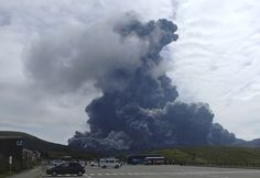 A column of black smoke rises from Mount Aso on the southern Japanese island of Kyushu Photograph: AP