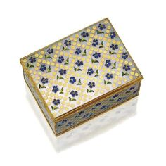 GOLD, ENAMEL AND MOTHER-OF-PEARL SNUFF BOX WITH FRENCH GOLD MOUNTS, FRENCH, MID 18TH CENTURY The rectangular box with hinged lid, the wavy chased gold cagework mounts enclosing later mother-of-pearl panels inlaid with enameled yellow-centered blue flowers sprinkled within a lattice of gold pellets, gold lined, 31/8 by 2½ inches, maker's mark ?D, charge and discharge marks of Antoine Leschaudel, Paris, 1747.