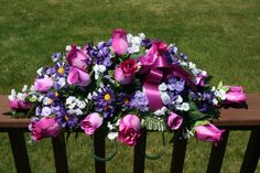 Cemetery Memorial Saddle on Etsy, www.picketfenceflowersandgifts.com can create this beautiful cemetery arrangement !