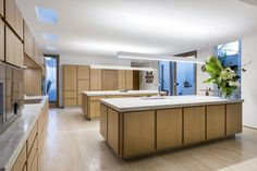 The heart of every home is most certainly the kitchen. Featuring European Oak cabinetry, Gaggenau appliances and 2 stunning quartzite island bench tops, our Lake Monger Residence has an amazingly huge heart. Cedar Walls, Travertine Floors, Pivot Doors, Island Bench, Luxury Kitchen Design, Home Automation System, Aluminium Windows, Australian Homes, Custom Homes