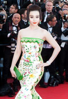 Chinese actress Fan Bing Bing attends the Opening Ceremony and screening of 'Moonrise Kingdom' at Cannes in a Chris Bu Kewen gown paired with watch, white gold rings and earrings by Chopard. Clutch by Elie Saab.
