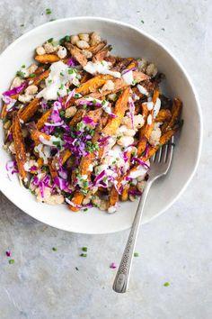 loaded sweet potato fries with crispy white beans and creamy garlic tahini cream, gluten-free, vegan