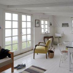 Summer Cottage, white wooden floors + walls, vintage elements | By Studio Oink