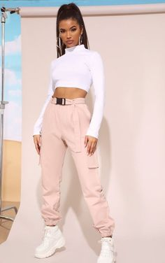These joggers are our new off-duty go-to. Featuring a nude material with a buckle belt and elasticated cuffs, team them with a simple white crop top and chunky sneakers for an off-duty outfit we're loving. off duty NUDE UTILITY BUCKLE BELT JOGGERS Teen Fashion Outfits, Edgy Outfits, Swag Outfits, Mode Outfits, Look Fashion, Outfits For Teens, Summer Outfits, Sporty Fashion, School Outfits