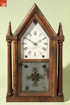 """This simple, mass produced clock is the type that was owned by many middle class Americans in the early years of the 19th century.  The pointed top and the steeples suggest the popular Gothic Revival Style.  The decorative floral etched glass is generic, suggesting no particular style.  The overall effect would be perfect for a picturesque """"cottage"""" interior."""