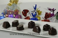 Moulded Chocolates And Chocoalte Rocks: Moulded chocolate and chocolate rocks made with a filling of pistachios, raisins, dry fruit chikki and chocolate ganache.