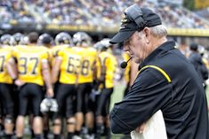 Former Appalachian State University coach Jerry Moore on the field with his team.