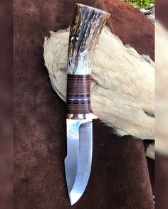 Harpoon point, 1084 high carbon steel, copper guard and spacer in the leather stack. Finished with whitetail antler butt. Contact me to get your name on the list for one of these! CJKnives1@gmail.com