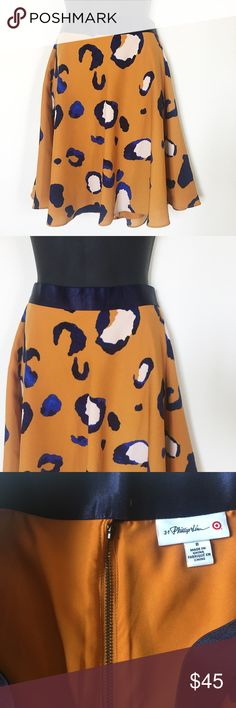 3.1 Phillip Lim for Target A-Line Leopard Skirt • 3.1 Phillip Lim X Target • Full Style Skirt • Cheetah / Leopard Print • Mid-rise, Lightweight, Flowy • Fully Lined, Back Zip, Hook & Latch  Size: 8 Color: Orange, Blue, White Condition: Excellent Used Condition - Like New Material: 100% Polyester *Stock photo shown for fit and style*  Measurements Waist: 30 inches Length: 21 inches All measurements are approximate.  No stains, rips, tears | Pet/Smoke free home. Offers welcomed ✨ 3.1 Phillip…