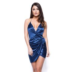 Our sexiest satin wrap dress has arrived and it's on fire! Short and backless, it features a deep plunging neckline to flaunt a fabulous bust, an asymmetric overlapped hem and a self-tie waist band to draw attention to your curves. Doll it up with barely there heels and plenty of lip gloss for a gorgeously glam party look. Features a deep plunging neckline, adjustable straps, wrapped waist with side tie and an asymmetric overlapped hem. Constructed from a soft and stretchy satin finished ...