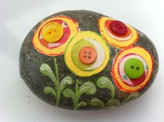 Buttons and beads are a great way to embellish painted stones