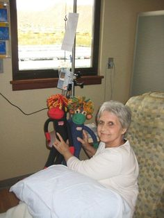 SMAC! - Sock Monkeys Against Cancer - monkeys NoMo & Phoenix gave Mom, Leslie Lehrman, some major sock monkey mojo today at chemo. They are helping her SMAC! that damn cancer!