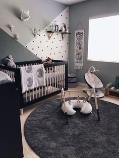 A monochrome zoo nursery. I wanted colors and patterns to really get his eyes trained and I knew that they can only see black, white and grey.