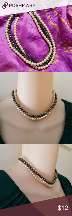 Vintage triple strand faux pearl choker necklace This lovely vintage choker necklace has three strands of lightweight faux pearls (black and creamy white). Rhinestone bar ends with hook and bead clasp. In very nice condition and from a smoke free home:)   KeyD8834nlce8y5r Vintage Jewelry Necklaces