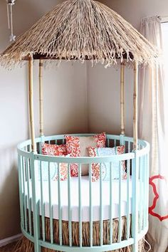 Awesome Tiki hut crib with mint green and orange accents. Tiki hut / surfer dude nursery